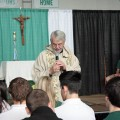 Fr. speaking to students during School Mass